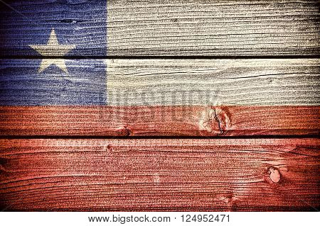 Republic of Chile painted on old grungy wooden background