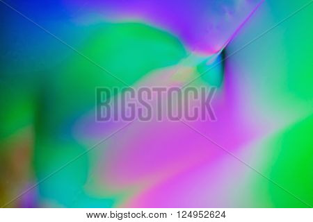 Colorful psychedelic blur showing stress distribution in plastic using polarized light