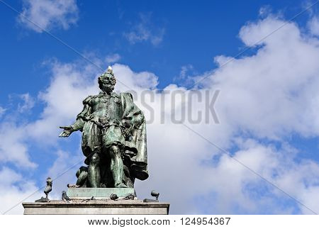 Statue of Rubens on the Groenplaats with the sky on the background, Antwerp, Belgium