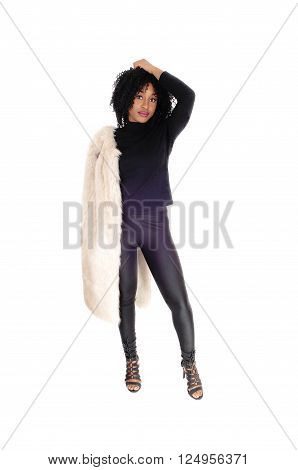 A serious young African American woman in black tights and sweater and 