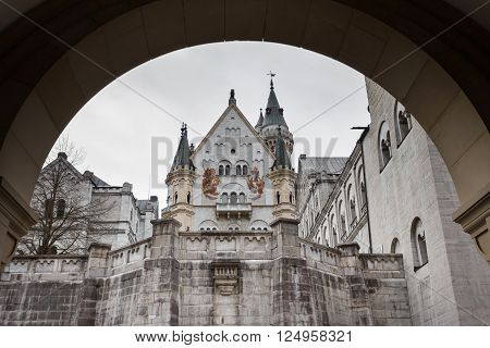 Schwangau Germany - January 06 2016: View of the Neuschwanstein Castle through the arch at winter time
