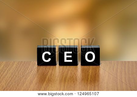 CEO or Chief Executive Officer on black block with blurred background