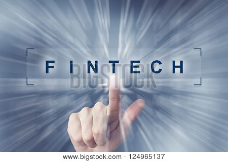 hand clicking on fintech or Financial technology button with zoom effect background