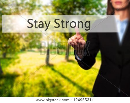 Stay Strong - Businesswoman Hand Pressing Button On Touch Screen Interface.