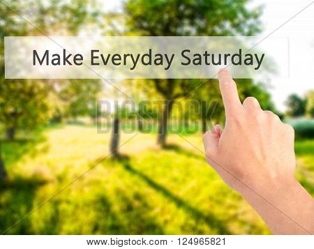 Make Everyday Saturday - Hand Pressing A Button On Blurred Background Concept On Visual Screen.