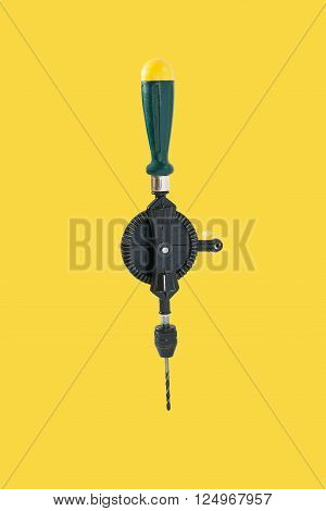 New hand drill. Isolated on a yellow background.