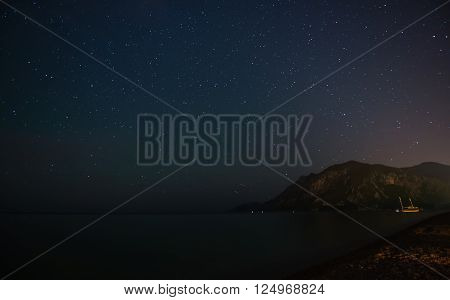 Starry sky at night at the sea coast in Cirali, Turkey - landscape exterior