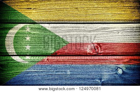 Flag of the Comoros painted on old grungy wooden background