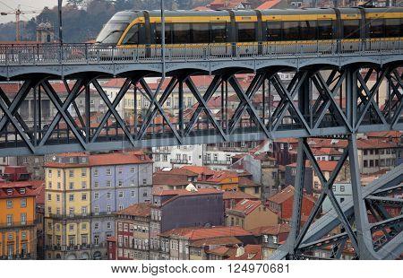 PORTO, PORTUGAL - November 26, 2014: metro train on with the Dom Luis bridge and  Porto city in the background