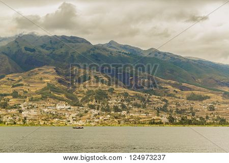 Day landscape scene photo of san pablo lake and mountain at background in Imbabura district in Ecuador, South America