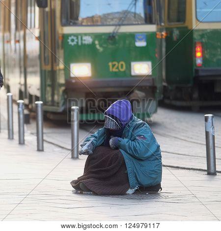 Helsinki, Finland - April, 4, 2016: homeless person in a center of Helsinki, Finland.