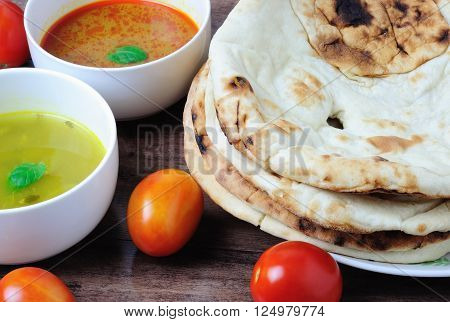 Nepalese/Indian Naan Flatbread with curry and dhal sauce a plain Indian roti also know as plain tandoori roti.