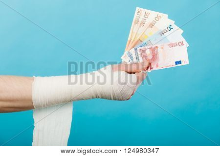 Male Bandaged Hand With Money.