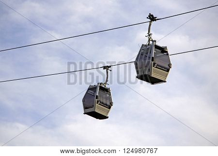 BARCELONA CATALONIA SPAIN - DECEMBER 13 2011: Two Teleferic De Montjuic gondolas in Barcelona's sky