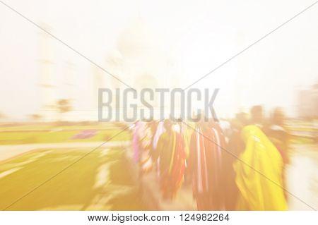 People walking through the Taj Mahal Concept