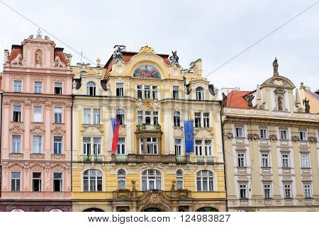 PRAGUE CZECH REPUBLIC - JULY 8 2009: Replica of the original baroque house At The Golden Star on the left Prague Municipal Insurance Company building and Pauline Monastery on the right