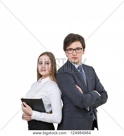 Businessman with hands crossed and businesswoman with notebook standing shoulder to shoulder. Isolated. Concept of team work.