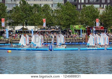 AMSTERDAM, THE NETHERLANDS, AUGUST 20, 2015: Kids are learning to sail at SAIL Amsterdam 2015, the largest free public sail event in the world.