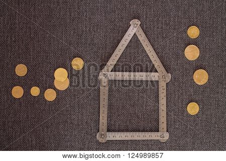 Built-Up Area Concept. House Meter Coins Abstraction