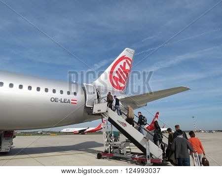 DUESSELDORF GERMANY - CIRCA OCTOBER 2013: Aircraft of the Niki Airlines (Airberlin partner) at the airport with passengers boarding