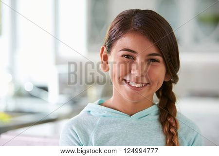 Head And Shoulders Portrait Of Hispanic Girl At Home