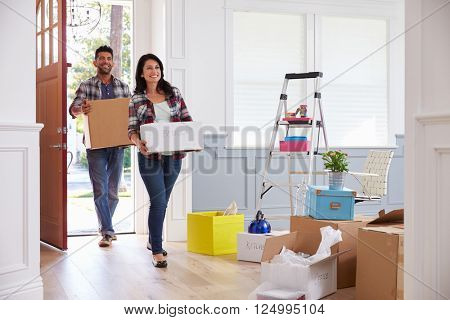 Hispanic Couple Moving Into New Home Together
