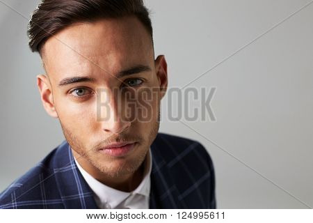 Elevated view of smartly dressed young man looking to camera