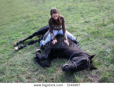 Girl And Stallion Laid Down