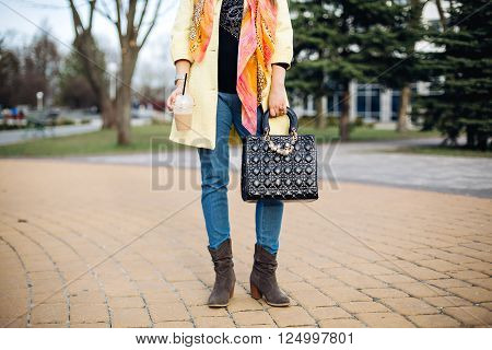 Part of women's outfit, spring outfit, walk, coffee, rest in the street, fashion coat, bright colored scarf, black leather bag, accessories