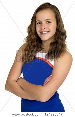 Young high school cheerleader standing smiling arms folded