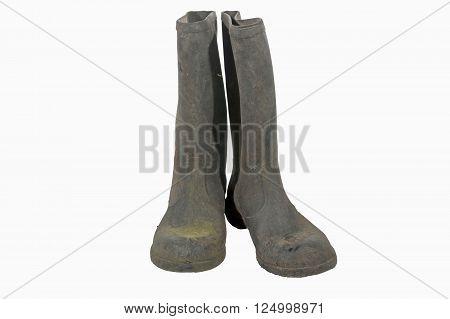 Isolated Pair Of Dirty Wellington Boots On White