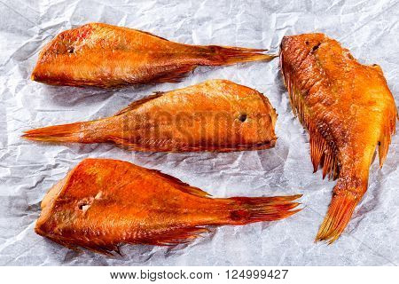 red sea bass on a parchment paper horizontal close-up