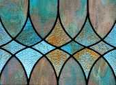 image of stained glass  - Detail of stained glass window depicts design with three diamond - JPG