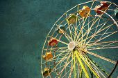 foto of ferris-wheel  - View of a carnival ferris wheel textured for a grunge effect - JPG