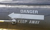 image of iroquois  - a danger sign pointing toward the tail rotor on a new zealand airforce iroquois helicopter - JPG
