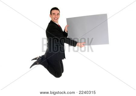 Businessman Jumping mit leere Plakat