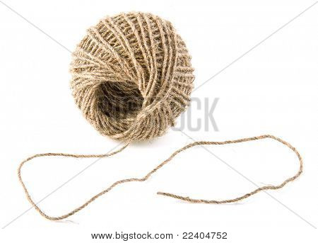 Clew of linen twine isolated on white
