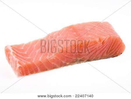 salmon fillet over white background