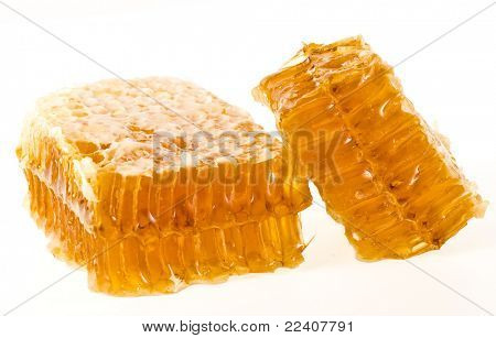 Golden honeycomb wax cell   isolated on white background