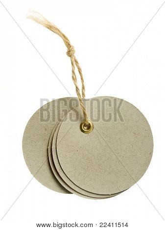 round cardboard blank tag label with string isolated on white background
