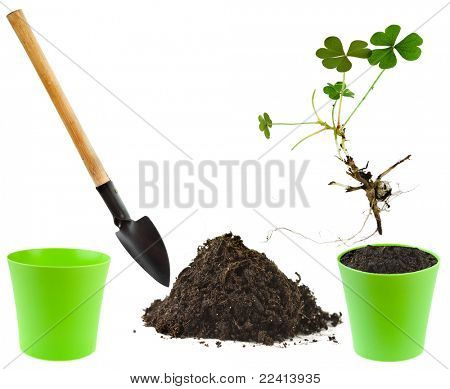 Gardening tool with dirt and flower pot isolated on white background
