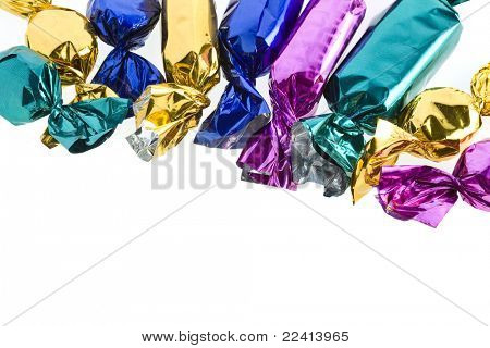 shining candy in color wrapper isolated on white