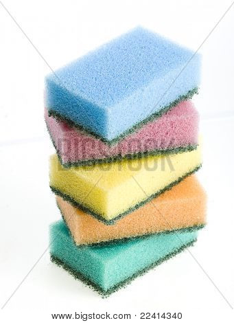 group of kitchen sponges with soapy foam on white background