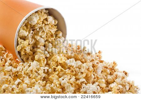 pop corn in caramel syrup  in the paper box isolated