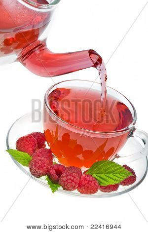 kettle with a cup of raspberry tea isolated