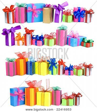 many colorful gift boxes with bows isolated