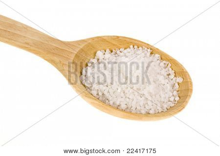Wooden spoon with sea salt isolated on white background