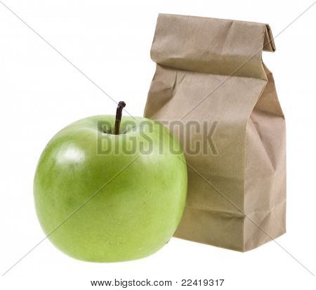 paper lunch bag with fresh apples on white