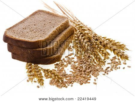 Piece of rye bread and grain wheat ears isolated on white