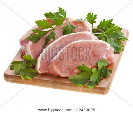 meat pork with herb parsley isolated on white